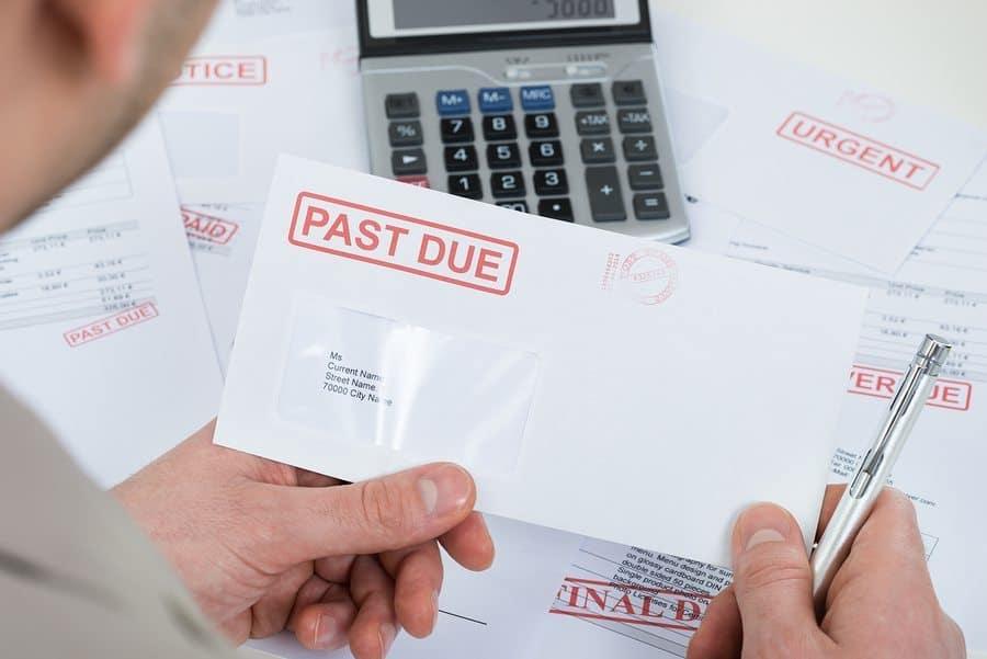 business loan default delinquency past due