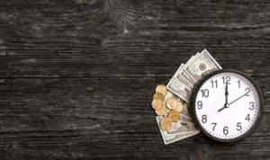 Get your merchant funds fast. Image description: Clock with money underneath it